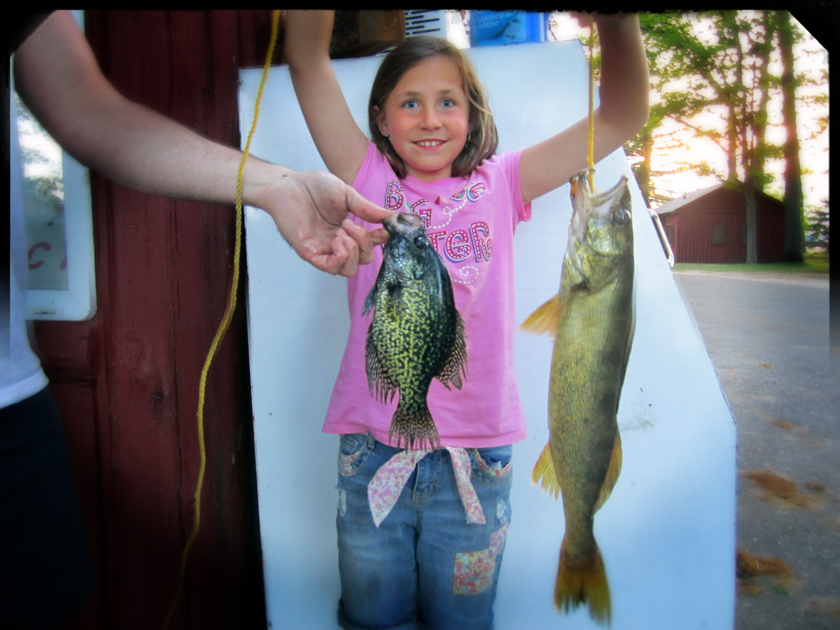 girl with fish she caught out of lake cadillac