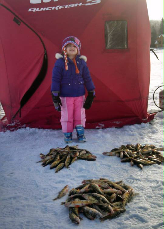 First ice fishing trip for Sierra on Higgins lake