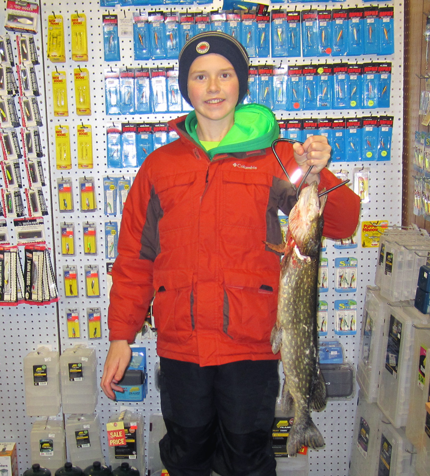 "Andrew Brands holds the 30"" pike he caught on Lake Mitchell."