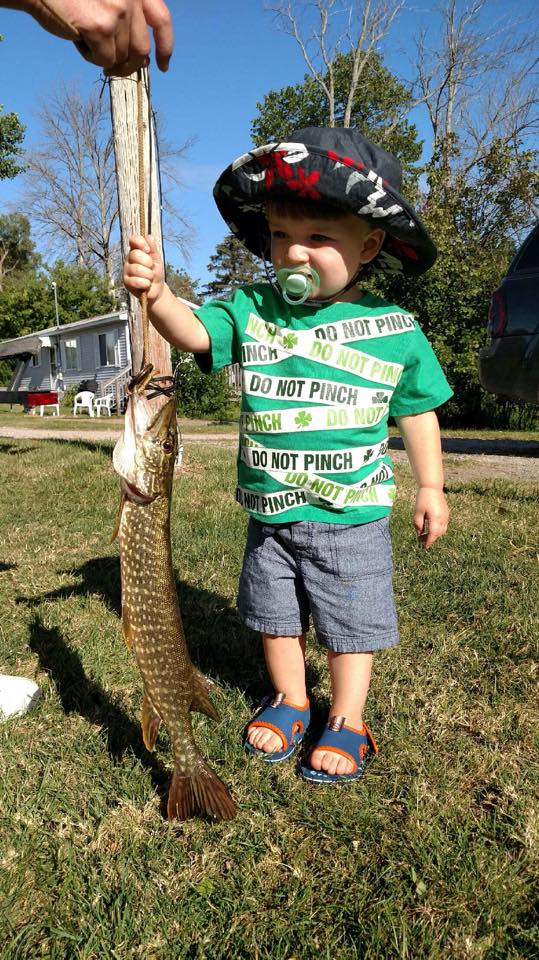 Patrick from Dayton, OH is showing off the Pike his grandpa caught on Houghton Lake
